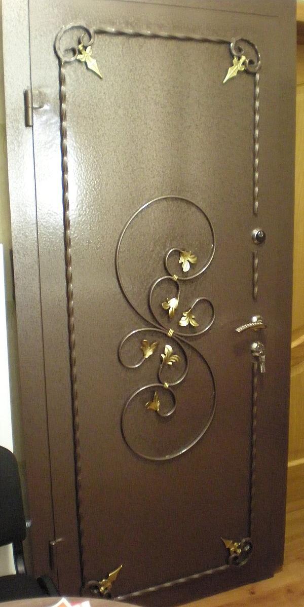 металлические кованые входные двери